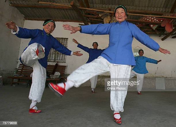 Members of the Bound Feet Women Dancing Team practise dancing at Liuyi Village on April 2 2007 in Tonghai County of Yunnan Province China Liuyi...