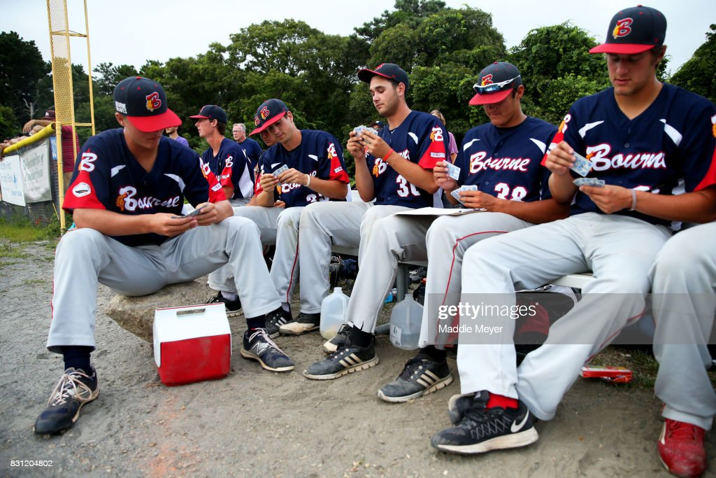 Members of the Bounre Braves play the card game President during game one of the Cape Cod League Championship Series against the Brewster Whitecaps at Stony Brook Field on August 11, 2017 in Brewster, Massachusetts. The Cape Cod League was founded in 1885 and is the premier summer baseball league for college athletes. Over 1100 of these student athletes have gone on to compete in MLB including Chris Sale, Carlton Fisk, Joe Girardi, Nomar Garciaparra and Jason Varitek. The chance to see future big league stars up close makes Cape Cod League games a popular activity for the families in each of the 10 towns on the Cape to host a team. Each team is a non-profit organization, relying on labor from volunteers and donations from spectators to run each year.