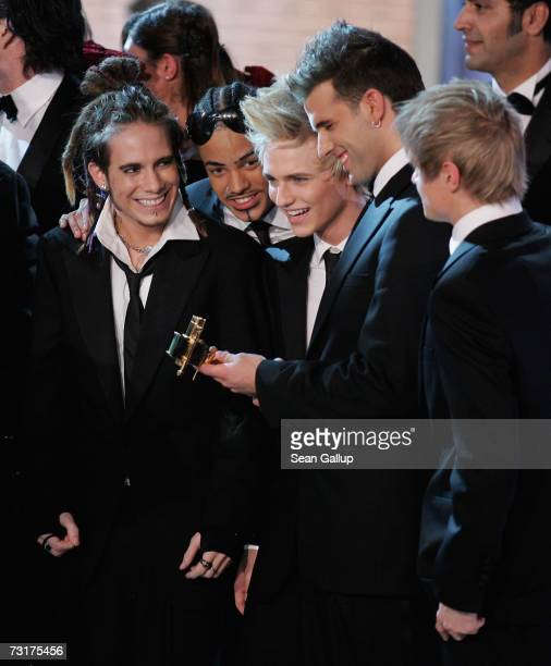 Members of the boy band US5 Izzy Gallegos Michael Johnson Richie Stringini Jay Kahn and Chris Watrin look at their Award for Best International Pop...