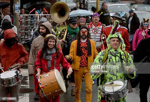 Members of the Brass Balagan Band of Burlington Vt are joined by other participants in the Annual Honk Festival of activist street bands in Davis...
