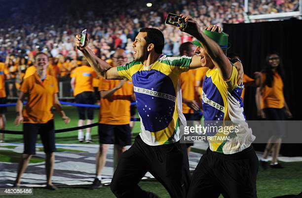 Members of the Brazil delegation run through the stadium during the closing ceremony for the 2015 Pan American Games at the Rogers Centre in Toronto...