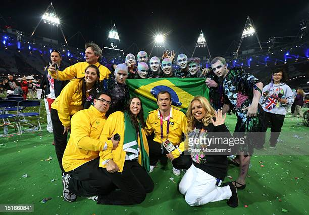 Members of the Brazil team pose with performers during the closing ceremony on day 11 of the London 2012 Paralympic Games at Olympic Stadium on...