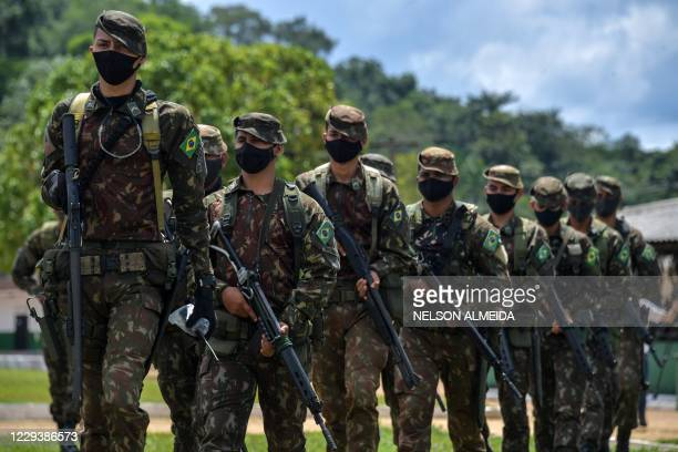 Members of the Brazilian Armed Forces take part in a military exercise as part of the Agata operation, on the Oiapoque River in Oiapoque, Amapa...