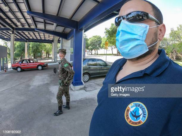 Members of the Brazilian Army and Supervisors of Imigration from Uruguay perform screening at the Concordia International Bridge on the second day of...