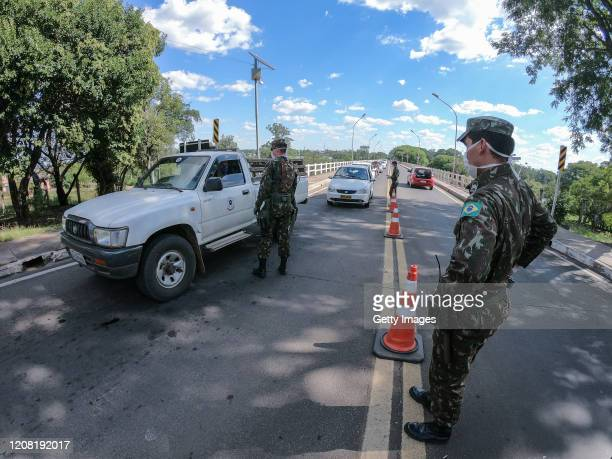 Members of the Brazilian Army perform screening at the Concordia International Bridge on the second day of the border closure between Brazil and...