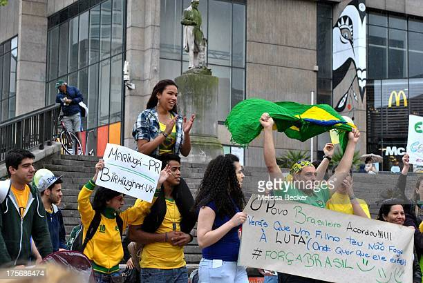 CONTENT] Members of the Brazilian community take part in a demonstration at the Birmingham city centre United Kingdom in support of the ongoing...