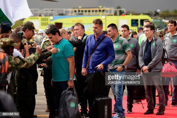 Members of the Brazilian football team Chapecoense are honored upon their arrival at the airport in Rionegro, near Medellin, Colombia, on May 8 two...