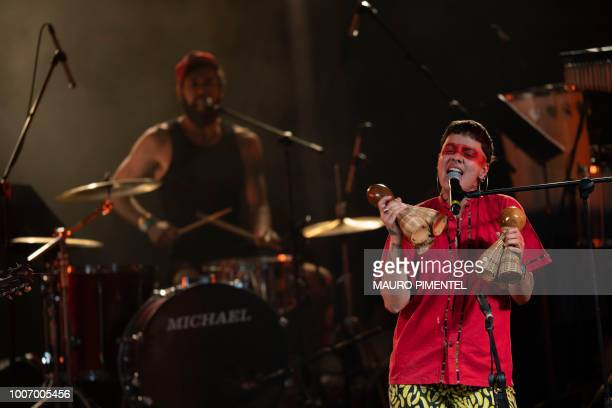 Members of the Brazilian music group Francisco El Hombre perform during the Lula Livre Music Festival in Rio de Janeiro Brazil on July 28 2018...
