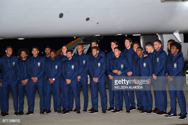 Members of the Brazilian national football team pose for pictures upon landing at Sochi airport in Russia on June 11 ahead of the FIFA World Cup