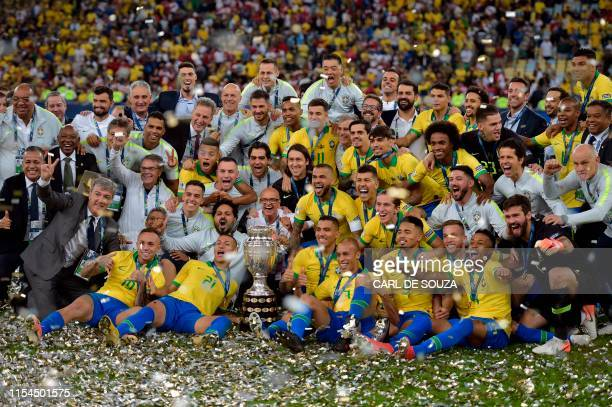 TOPSHOT Members of the Brazilian national team celebrates with the trophy after winning the Copa America after defeating Peru in the final match of...