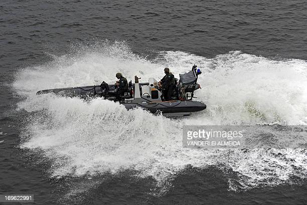 Members of the Brazilian Navy take part in a terrorist attack drill as part of the security measures for the upcoming FIFA Confederations Cup the...