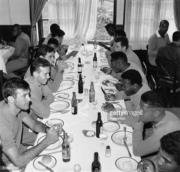 Members of the Brazilian World Cup football team at a dinner table at their training camp in Nova Friburgo Brazil 1962 Among the players are...