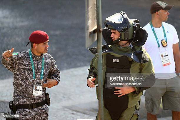 Members of the Brazillian bomb squad carry out a controlled explosion of a bag near the finish line of the Men's Road Race on Day 1 of the Rio 2016...