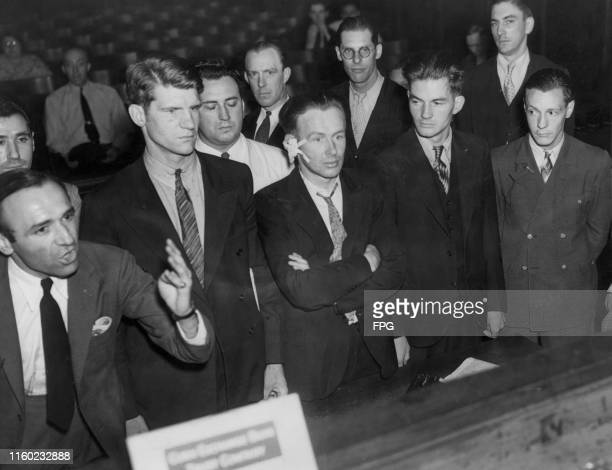 Members of 'The Bremen Six', facing charges at the 47th Street Police Station, after they took part in an anti-Nazi protest in which they had seized...