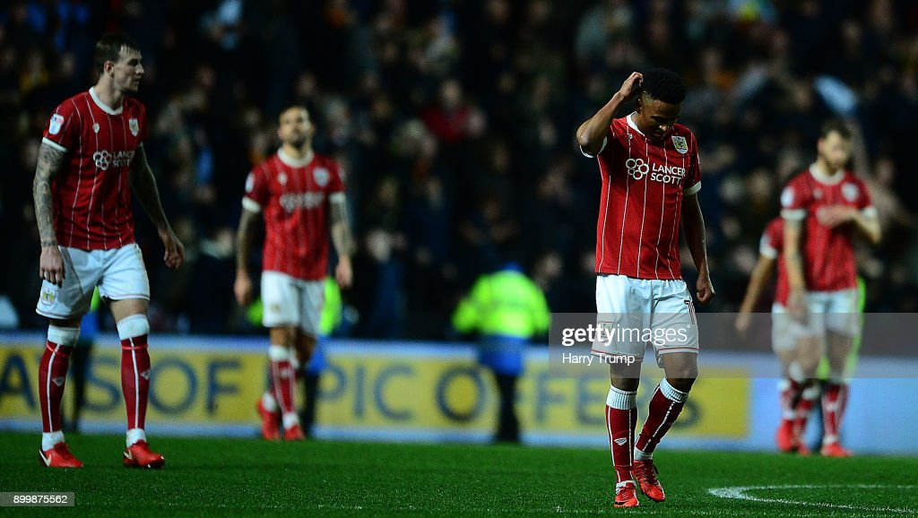 Members of the Bristol City side cut dejected figures as Ryan Bennett of Wolves(not pictured) scores his sides winning goal during the Sky Bet Championship match between Bristol City and Wolverhampton Wanderers at Ashton Gate on December 30, 2017 in Bristol, England.