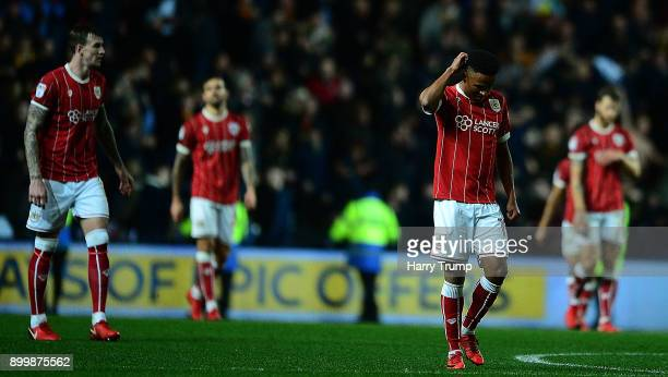 Members of the Bristol City side cut dejected figures as Ryan Bennett of Wolves scores his sides winning goal during the Sky Bet Championship match...