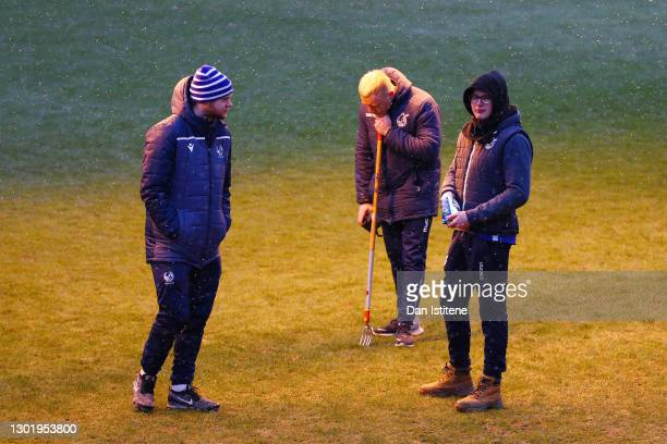 Members of the Bristol Rovers ground staff stand on the pitch after the Sky Bet League One match between Bristol Rovers and Swindon Town was...