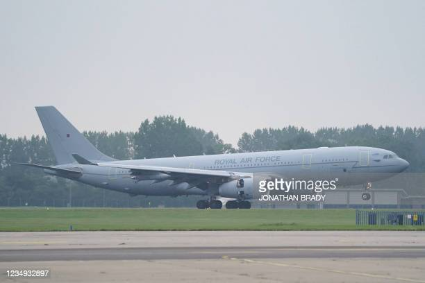 Members of the British armed forces and diplomatic staff arrive on a flight from Afghanistan at RAF Brize Norton, west of London on August 29 after...