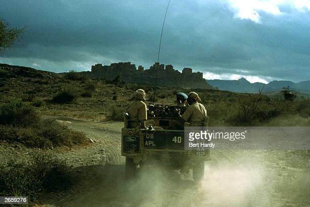 Members of the British army driving through Aden Original Publication Picture Post 9105 RAF And Cameron Highlanders In Aden unpub