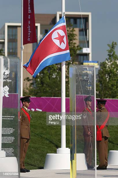 Members of the British Army raise a North Korea's flag during he Olympic Team Welcome Ceremony at the Athletes' Village at Olympic Park on July 25...