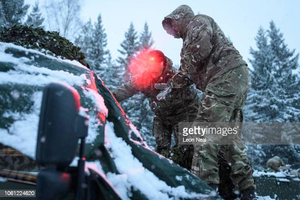 Members of the British Army Royal Irish Regiment B Company break down their temporary camp in the heavy snow as dawn breaks on October 30 2018 in...