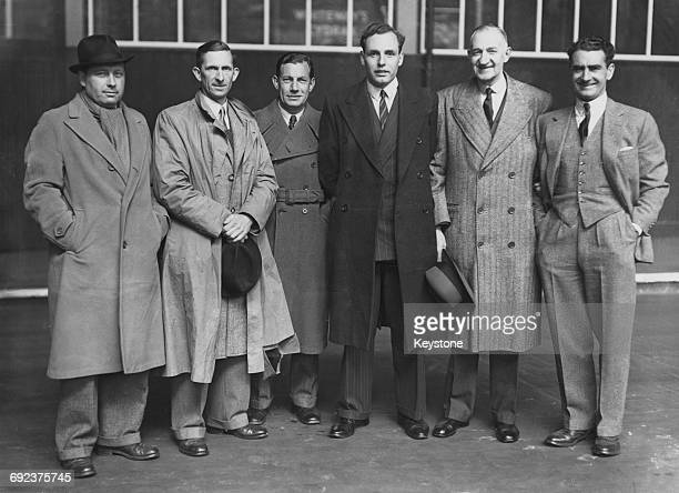 Members of the British Davis Cup team leaving Victoria Station in London for Paris 6th May 1946 Pictured are Donald MacPhail Henry Billington John...