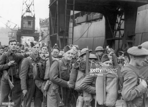 Members of the British Expeditionary Force withdraw to England from Dunkirk during World War II 1940