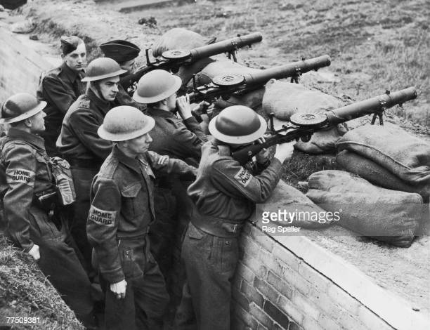 Members of the British Home Guard undergo training with Lewis Guns on a shooting range during World War II, 19th March 1941.