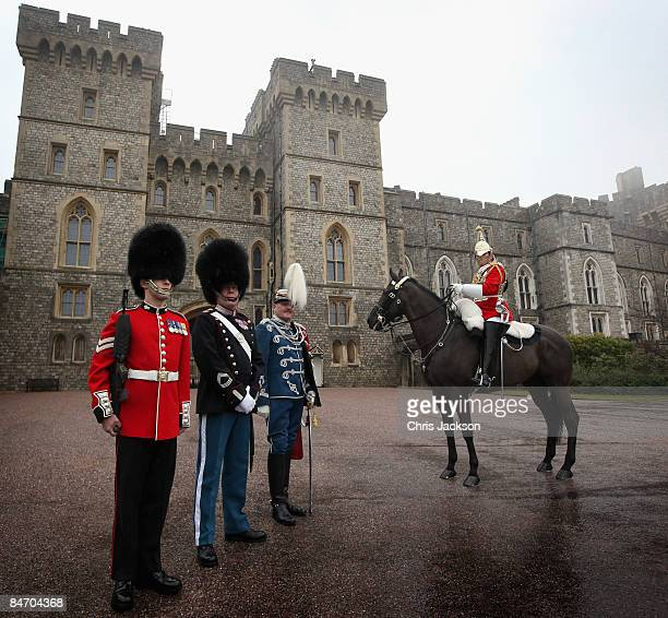 Members of the British Household Cavalry and Grenadier Guards pose for a photograph with a member of the Danish Guard Hussars at a photocall for the...