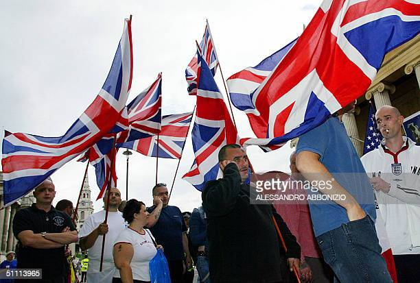 Members of the British National Front party march through London 25 July 2004 as they wait for the radical Islamic party AlMuhajiroun to arrive for...