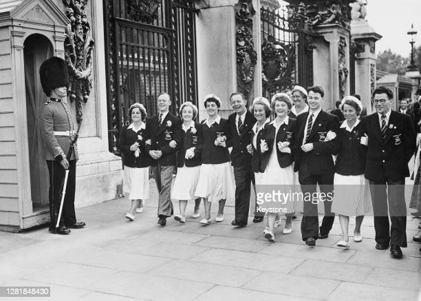 Members of the British Olympic team leave Buckingham Palace in London after receiving the good luck wishes of Queen Elizabeth II for the Summer...