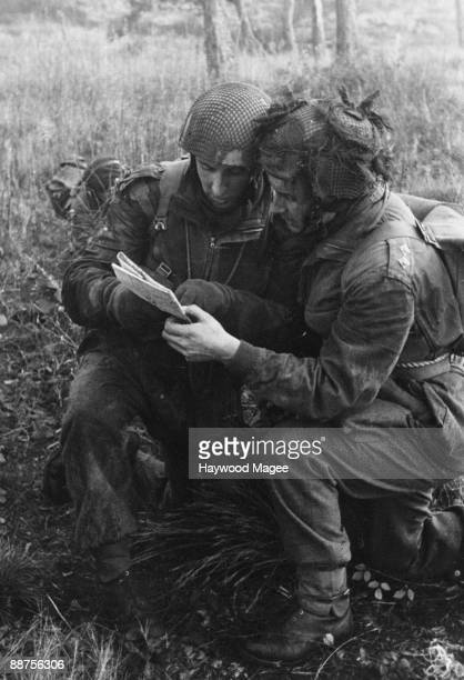 Members of the British Parachute Regiment check their position on a map during a training exercise 18th March 1944 Original publication Picture Post...