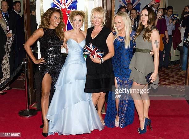 Members of the British pop girl group Spice Girls Melanie Brown , Geri Halliwell , Emma Bunton and Melanie Chisholm pose with producer Judy Cramer as...