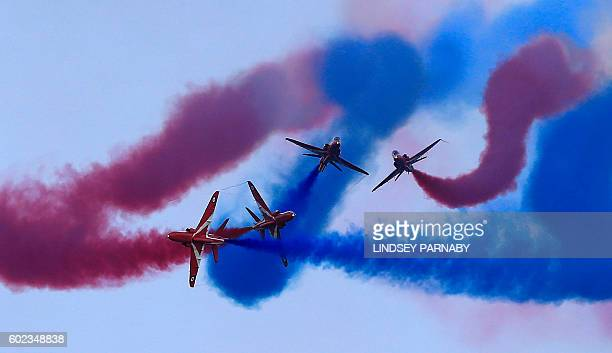 Members of the British Royal Air Force Aerobatic Team the Red Arrows perform at the Great North Run halfmarathon in South Shields north east England...