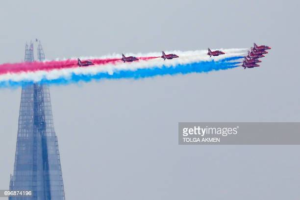 TOPSHOT Members of the British Royal Air Force Aerobatic Team the Red Arrows fly in formation past The Shard skyscraper as they perform a flypast...