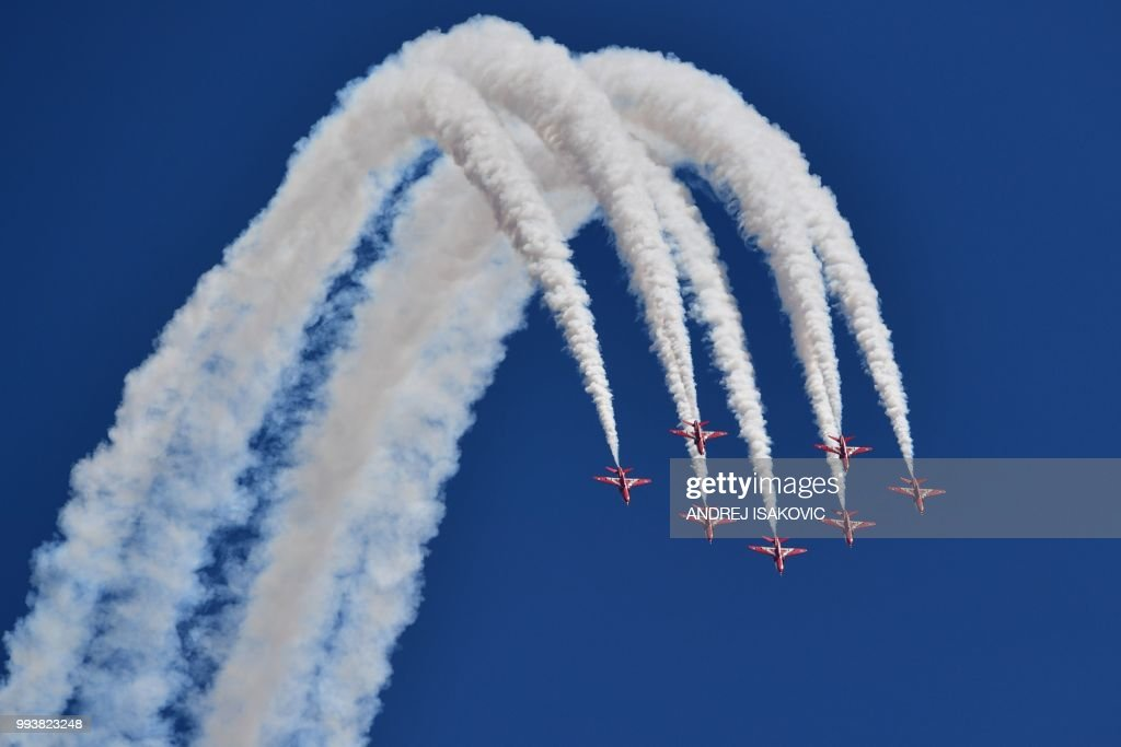 TOPSHOT - Members of the British Royal Air Force Aerobatic Team, the Red Arrows, perform ahead of the British Formula One Grand Prix at the Silverstone motor racing circuit in Silverstone motor racing circuit in Silverstone, central England, on July 8, 2018.