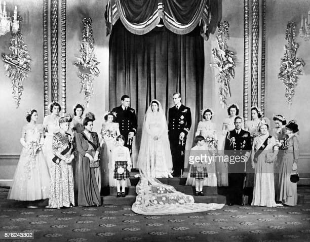 Members of the British Royal family and guests pose around Princess Elizabeth and Philip Duke of Edinburgh at right the group includes Britain's King...