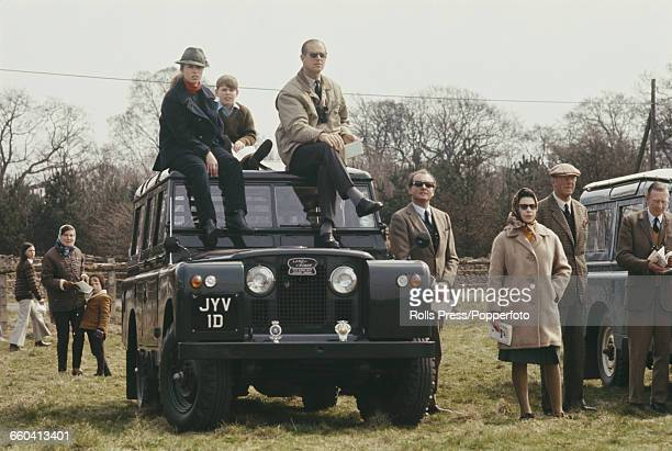 Members of the British royal family including Queen Elizabeth II standing with Henry Somerset 10th Duke of Beaufort beside a Land Rover Series IIA...