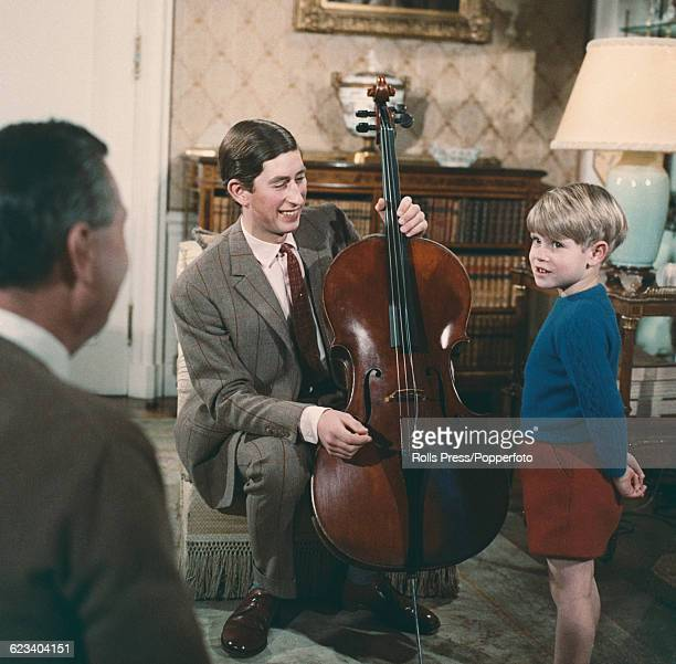 Members of the British Royal Family Prince Charles holding a cello instrument pictured together with Prince Edward during filming of the television...
