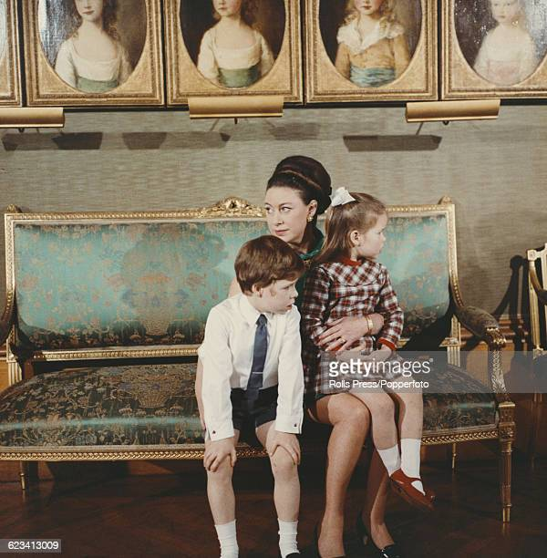 Members of the British Royal Family, Princess Margaret, Countess of Snowdon pictured holding her children, David Armstrong-Jones, Viscount Linley and...