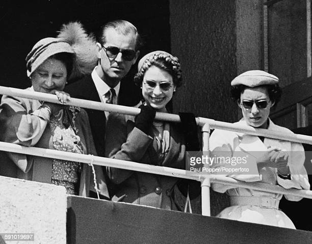 Members of the British Royal Family the Queen Mother Prince Philip Duke of Edinburgh Queen Elizabeth II and Princess Margaret watch the races with...