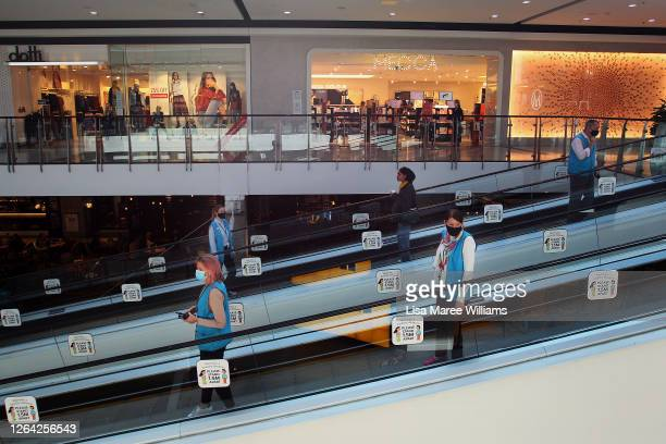 Members of the Broadway Shopping Centre team are seen social distancing on a travelator on August 06, 2020 in Sydney, Australia. Mirvac Retail has...