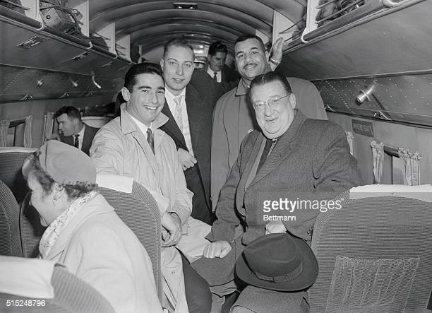 Members of the Brooklyn Dodgers, pitcher Sandy Koufax, pitcher Johnny Podres, catcher Roy Campanella, and team owner Walter O'Malley on a plane at La...