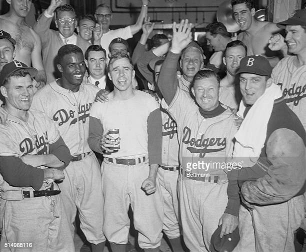 Members of the Brooklyn Dodgers smiled happily, and shouted for joy, in their dressing room after defeating the Philadelphia Phillies 9-8, to tie...