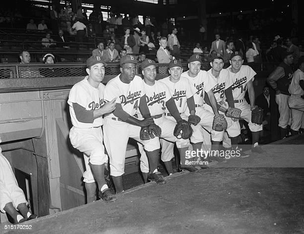 Members of the Brooklyn Dodgers who will be in the National League roster for the allstar game at Philadelphia on July 8 stand in front of their home...