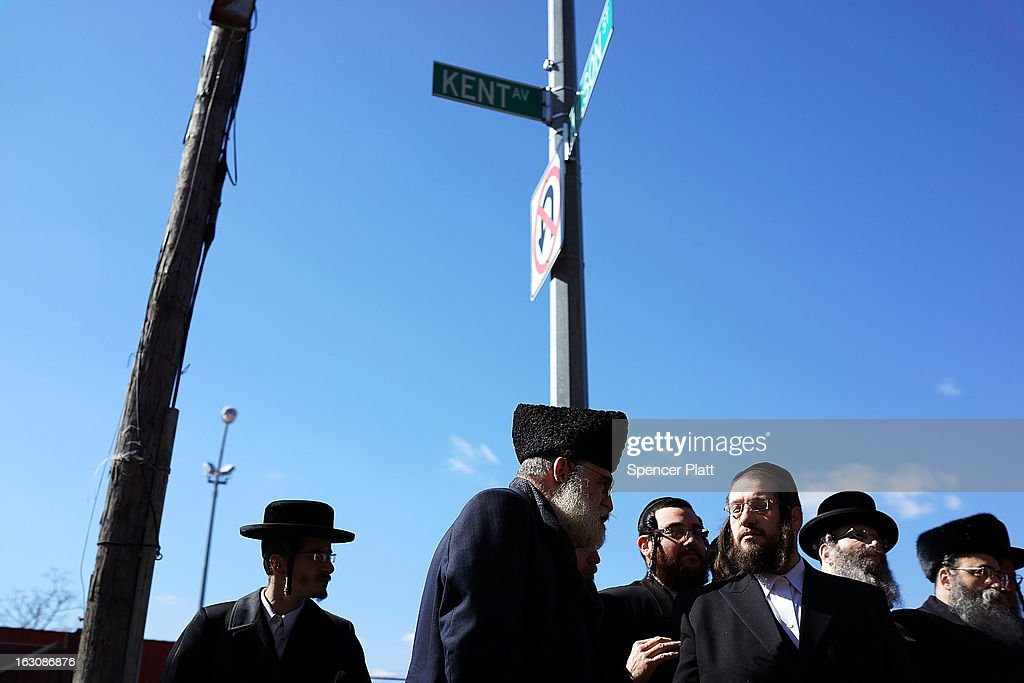Members of the Brooklyn Orthodox Jewish community attend a news conference to discuss the recent deaths of an Orthodox couple and their unborn child in a hit and run crash in the Brooklyn borough on March 4, 2013 in New York City. The couple, Nachman and Raizy Glauber, were on the way to the hospital to deliver their baby early Sunday morning when the livery cab they were in was hit by a BMW going at a high rate of speed. Doctors managed to temporarily save the Glauber's baby boy through a cesarean section, but the 21 year-old couple died early Sunday. The baby died shortly after on Monday at Bellevue Hospital. New York City police are searching for the driver and a passenger of the BMW who left the scene of the accident..