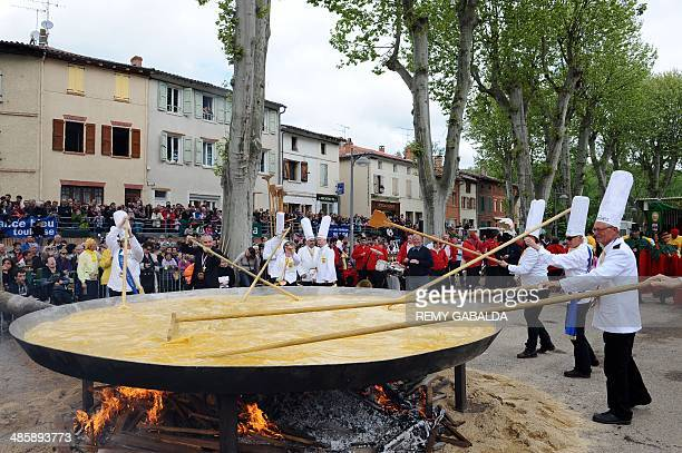 Members of the brotherhood of the Bessieres' giant Easter omelette prepare a giant omelette with thousands of eggs on April 21 2014 in Bessieres...