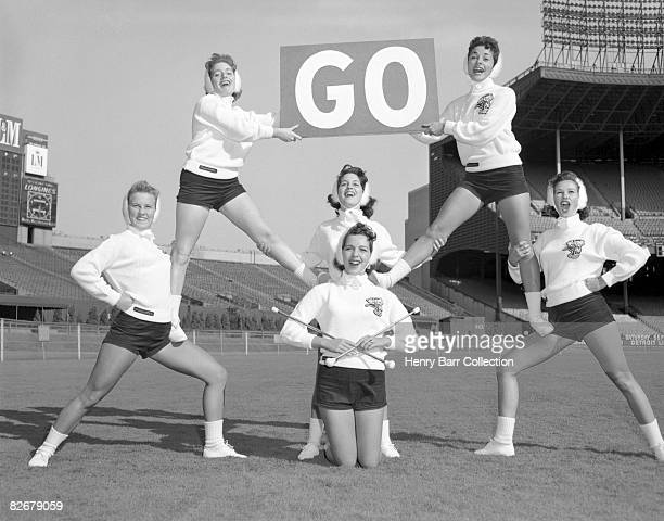 Members of the Brownettes cheerleading squad for the Cleveland Browns pose for a portrait on September 9 1958 at Municipal Stadium in Cleveland Ohio...