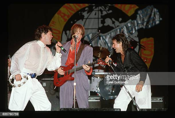 Members of the bubblegum pop band The Monkees Mickey Dolenz Peter Tork and Davy Jones perform on a 20th anniversary tour