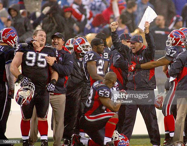 Members of the Buffalo Bills celebrate after winning their first game of the season against the Detroit Lions at Ralph Wilson Stadium on November 14...